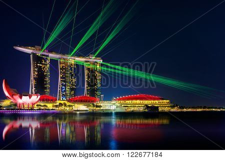 SINGAPORE -AUGUST 22: Wonderful laser show at the Marina Bay waterfront in Singapore. Marina Bay Sands Hotel dominates the skyline at Marina Bay on Aug 22, 2015.