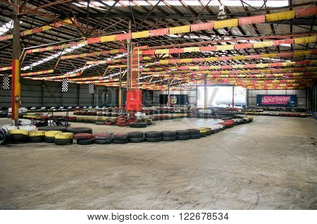 O'CONNOR,WA,AUSTRALIA-MARCH 5,2016: Indoor Kart Hire location with go karts and colourful tire boundaries and flags in O'Connor, Western Australia.