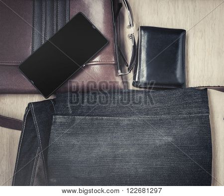 Outfit of traveler, Different objects on wooden background, Vintage style and dark tone