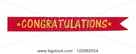 Congratulations banner isolated on white background.Golden glitter word on red suede fabric.