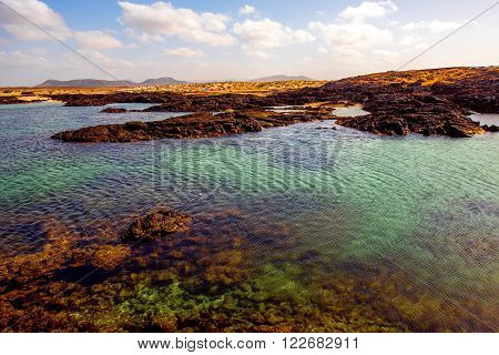 Volcanic coast with colorful water on the nothern part of Fuerteventura island near El Cotillo village in Spain