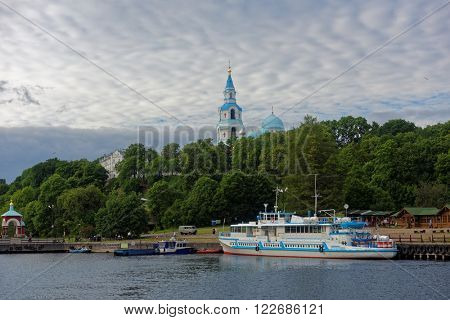 VALAAM ISLAND, RUSSIA - JULY 29, 2015: Ferry boat at the quay of Valaam monastery. About 100,000 pilgrims arrive in the Valaam monastery annually, 90,000 of which are tourists