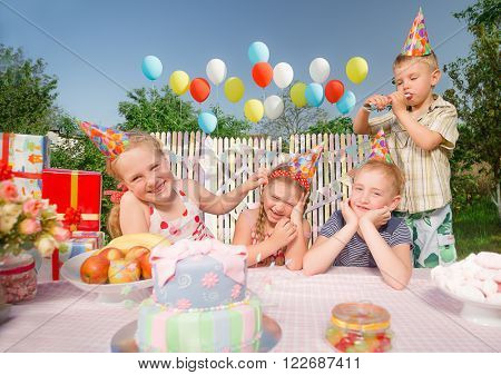 Little girl rejoice in her birthday round about her very emotional friends