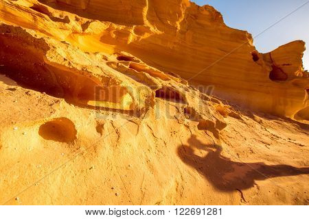 Natural dried riverbed with beautiful solid sand shapes on Fuerteventura island in Spain