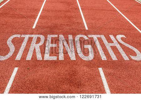 Strengths written on running track