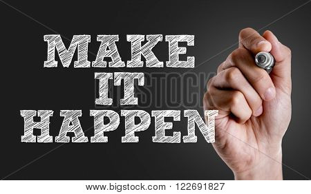 Hand writing the text: Make it Happen