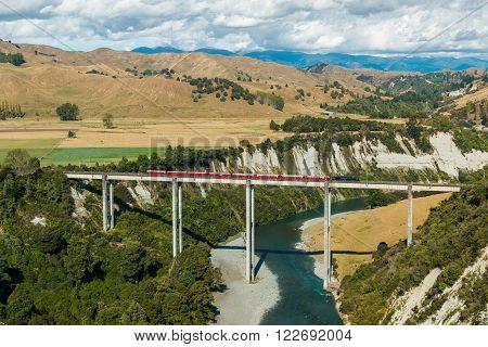 Stream train cross over one of New Zealand tallest trestle bridge over the Rangitikei river.