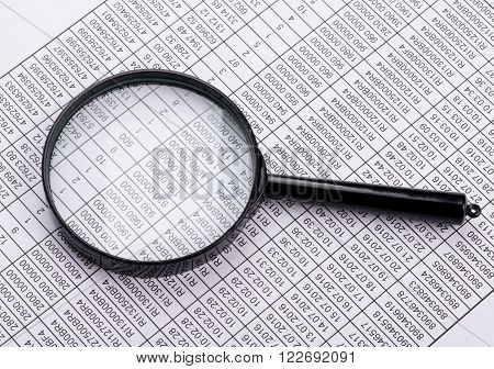 Magnifying glass lies on the statement printed on paper.
