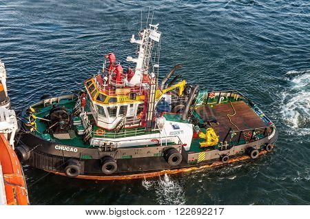 Punta Arenas Chile - December 9 2012: Tugboat Chucao work at the port of Punta Arenas in Patagonia Chile South America