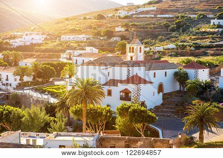 View on Betancuria village with church tower on Fuerteventura island in Spain