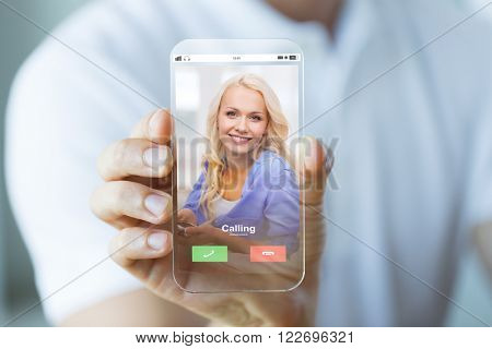 business, future technology and people concept - close up of male hand holding and showing transparent smartphone with incoming call on screen