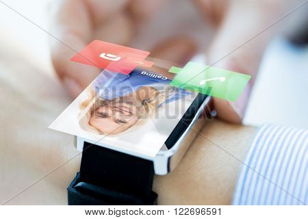 business, communication, technology and people concept - close up of woman hands setting smart watch with incoming call
