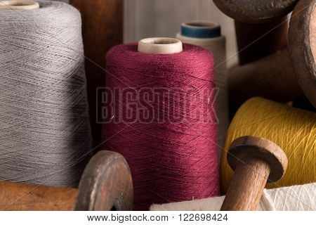 Maroon Thread Alongside Other Colour Thread