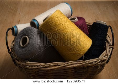 Bunch Of Spools Of Thread In Woven Basket