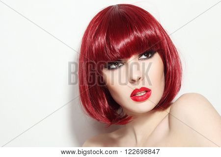Portrait of young beautiful sexy red-haired girl with bob haircut and stylish make-up looking upwards