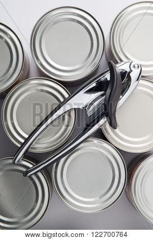 Overhead Shot Of Can Opener On Tin Cans