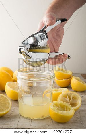Lemon Press Squeezing A Lemon