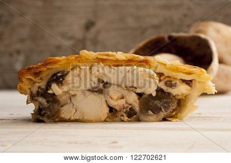 Half Of Chicken And Mushroom Pie With Fresh Mushrooms