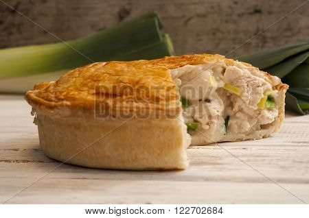 Chicken And Leek Pie With Slice Missing And Fresh Leeks