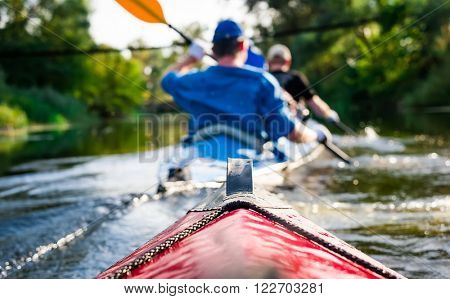 rowers on canoe floating to shore