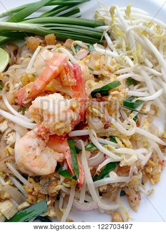 Delicious Rice Noodles With Shrimp Close-up On A Plate.