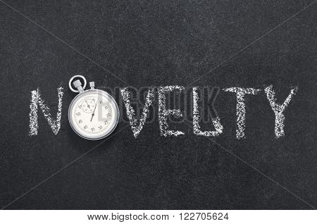 novelty word handwritten on chalkboard with vintage precise stopwatch used instead of O