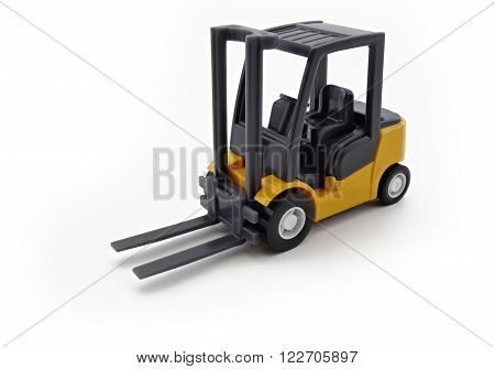 scale model forklift truck on a white background