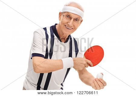 Active senior playing ping-pong and smiling isolated on white background