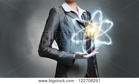 Woman scientist presenting atom research concept