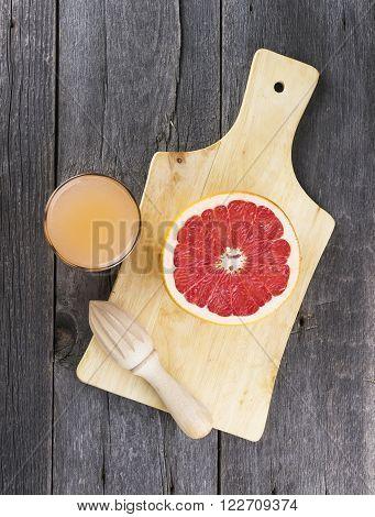 Grapefruit Juice In Glass Glass On Dark Wooden Background. Top View