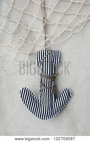 Textile anchor tied with rope and a fish net