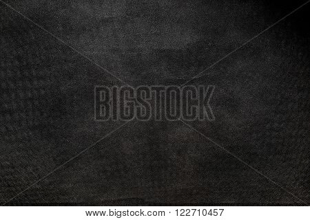 Dark grey fibrous texture with large cells.