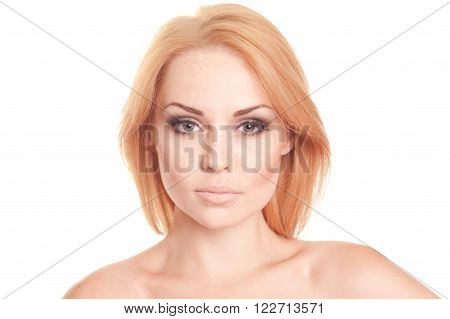 Beautiful blonde girl 20-25 year old posing over white. Closeup portrait of young woman looking at camera. Isolated.