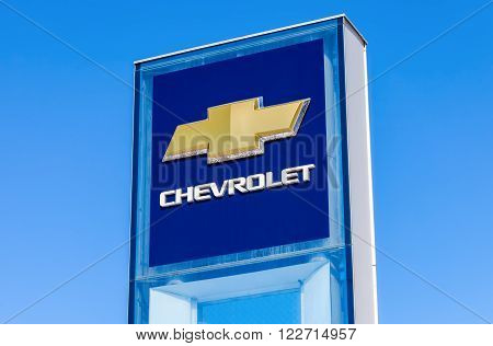 SAMARA RUSSIA - MARCH 20 2016: Chevrolet dealership sign against blue sky. Chevrolet is a American automobile manufacturer
