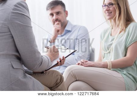 Young woman and her husband taking advice at psychiatrist