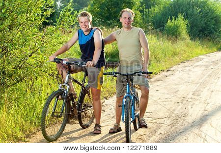 The father with the son on bicycles