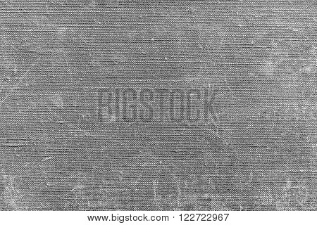 rough texture of old material from cotton or from a sackcloth for a textile background or for wallpaper of gray color with attritions