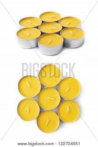 Pile of tealight paraffin wax yellow candles isolated over the white background, set of two different foreshortenings