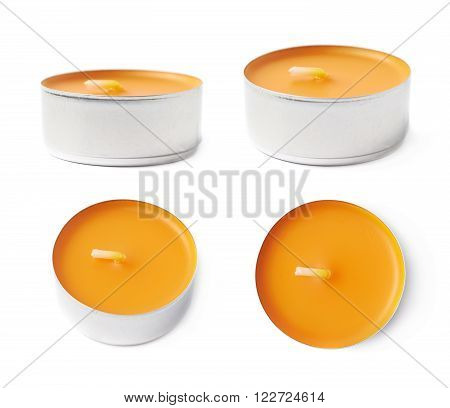 Single tealight paraffin wax orange candle isolated over the white background, set of four different foreshortenings