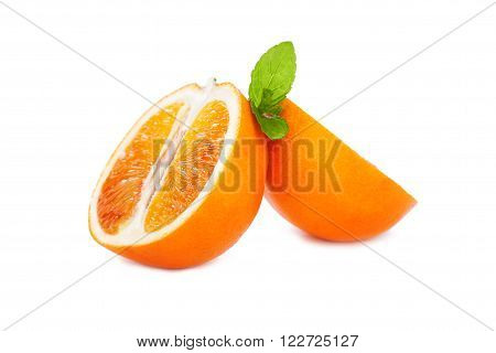 Fresh juicy blood cut oranges with mint leaf on a white background closeup