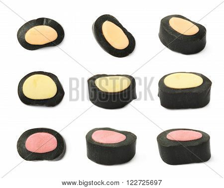 Black licorice candy with a sweet core, isolated over the white background, set of nine different foreshortenings
