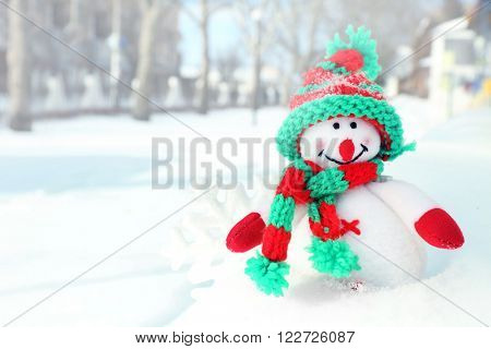 Beautiful snowman on natural snowdrift, close up