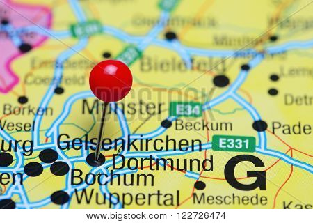 Photo of pinned Dortmund on a map of Germany. May be used as illustration for traveling theme.