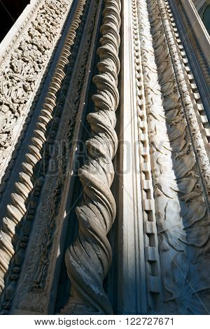 Detail of columns and inlay works in white marble of the Cathedral of Santa Maria del Fiore in Florence Tuscany Italy