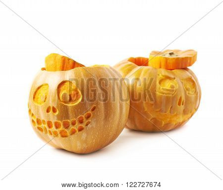 Two Jack-O-Lantern pumpkins, composition isolated over the white background