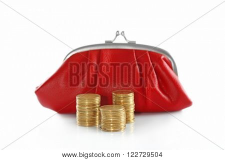 Red purse and stacked coins isolated on white