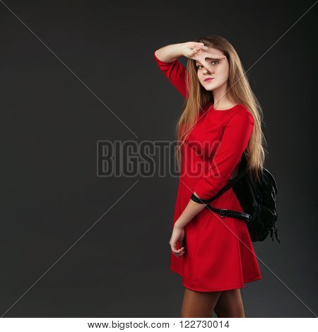 Portrait Of A Girl In A Red Dress With A Black Leather Backpack