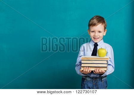 Cheerful Smiling Little Kid Against Chalkboard