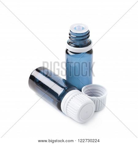 Two small blue glass flask vials, composition isolated over the white background