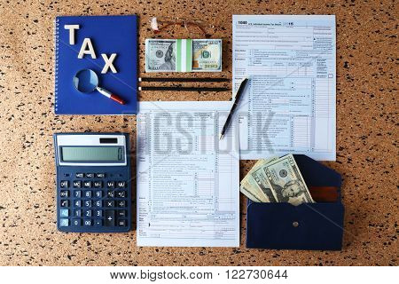 Individual income tax return, form 1040 with calculator and notebook on table